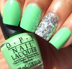 Lime green nails with a silver glitter accent nail