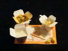 Miniature Chinese take out boxes.