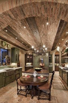 Different Kitchen Island Ideas and Designs (Photos) Luxury kitchen with arched brick ceiling and long center island with an attached cozy table for two.Luxury kitchen with arched brick ceiling and long center island with an attached cozy table for two. Style At Home, Tuscan Style, Tuscan Design, Luxury Kitchens, Tuscan Kitchens, Dream Kitchens, Outdoor Kitchens, Custom Kitchens, Rustic Kitchen