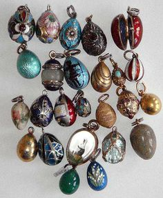 A selection of antique Russian miniature eggs in gold and silver by various makers, including Faberge.