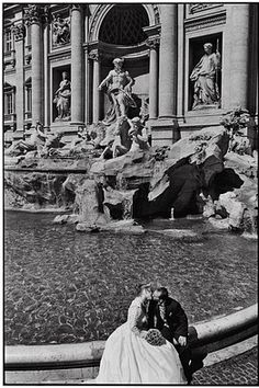 Rome, at the Trevi fountain. Check! I even have pictures of me and my friends throwing coins into the fountain :)