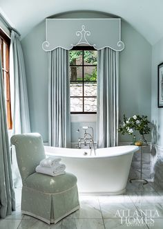 """Farrow & Ball's Pale Powder and tonal glazed linen draperies by Willard Pitt set a serene tone for """"her"""" side of the master bathroom. The valence is reminiscent of the Dorothy Draper era, a period of design that designer and homeowner Angela Bromenschenkel greatly admires. Beautiful Bathrooms, Elegant Bathroom, Cheap Home Decor, Bathroom Design, House Interior, Home, Interior, Room Design, Chic Interior Design"""