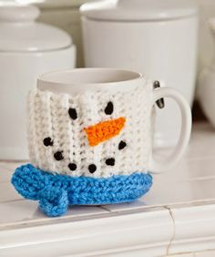 Snowman Mug Hug Crochet Pattern Cozy up with a hot cocoa or other warm beverage! This mood lifting crocheted mug cozy is a great gift idea Perfect with a Cheeky Witch Coffee / Tea mug filled with treats, hot chocolate or tea or coffee Crochet Snowman, Christmas Crochet Patterns, Holiday Crochet, Easy Crochet Patterns, Scarf Patterns, Crochet Ideas, Knitting Patterns, Crochet Coffee Cozy, Crochet Cozy