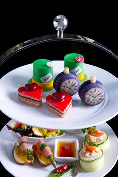 The Mad Hatter Tea - Westin, Sydney, Australia | served with a Blue Berry Crush Cocktail | blueberry macaron, strawberry + chocolate heart cake, chocolate mud cake hat, twiddle dee + twiddle dum sandwich, Alice's inside out crab sandwich + salad