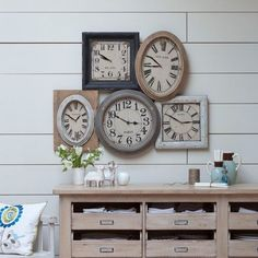 All these drawers and the clock collection!  Love the wall