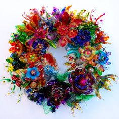 Plastic bottle flower door wreath, Recycled Art, Plastic Bottle Art Centerpiece, Art Statement, Abstract Colorful Wall Art CHihULy inspired plastic bottle flower wreath by ArtePlastique Plastic Bottle Art, Plastic Bottle Flowers, Plastic Art, Recycle Plastic Bottles, Pop Bottle Crafts, Plastic Recycling, Melted Plastic, Recycled Art Projects, Recycled Crafts