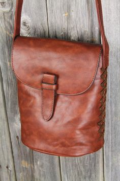 Blanket Stitch Genuine Leather Cross-body. Must buy this soon!! Looks like it is the same color as much beloved brown boots