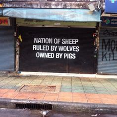 A nation of sheep, ruled by wolves, owned by pigs.  [Keep the animals out of the conversation, because I think they animals would be offended by this statement]
