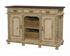 Guildmaster- Three Drawer Buffet w/ Baskets  Italian slate finish with Italian meadow green trim and woodlands dark stain top on solid wod buffet. 2 side doors open to one adjustable shelf each. Center holds 2 removable rattan baskets. Antiqued hardware. 3 drawers  60x24x42  $3012   Get measurements for center shelves!