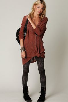 With A Knotted Sweater Dress — Give your light sweater dresses a dash of sex appeal by knotting them up high on your thigh. Wear them with some splashy leggings for a cute weekend look.