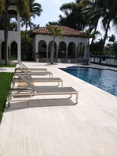 Pool deck featuring x Coliseum Stone Rustic Travertine tiles.