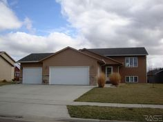 612 Eagle Ave., Harrisburg SD $173,700  MLS 21206239  Amazing 4 bedroom Split Foyer!Upgrades Galore!Surround Sound System,Stainless Steel Appliances,6 panel doors,Transom Windows,Recessed lighting,Vaulted Ceilings and much more!The living room is spacious with grid windows, a dream Kitchen with many cabinets, upgraded light fixtures, and lots of cabinets! Lisa Touney (605) 310-1162