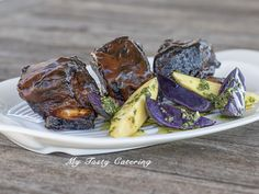 fall off the bone tender short rib tossed in homemade BBQ sauce broiled to perfection served w/ herb roasted fingerling potatoes