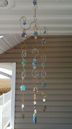 catcher, Wire wrapped marbles and beads wind chime. wire work window charm spins, hand made by me. by margiesun catcher, Wire wrapped marbles and beads wind chime. wire work window charm spins, hand made by me. by margie Suncatchers, Carillons Diy, Sell Diy, Bijoux Fil Aluminium, Diy Wind Chimes, Shell Wind Chimes, Easy Crafts To Make, Simple Crafts, Garden Crafts