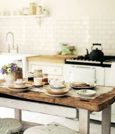 Subway tile, check. Farmhouse sink, check.  Rustic wooden island, a new must-have element?