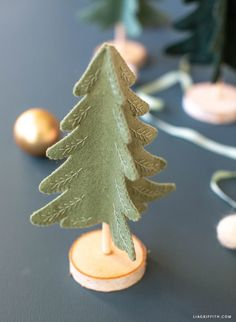 Mini Felt Christmas Tree with Embroidery - Lia Griffith - - Mini trees are a popular Christmas decoration that are simple to make. So before you buy any, we say try making this felt Christmas tree first! Christmas Makes, Noel Christmas, Homemade Christmas, Winter Christmas, Nordic Christmas, Modern Christmas, Tree Crafts, Christmas Projects, Holiday Crafts