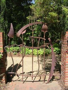 A wacky garden gate which tells you that the owners enjoy gardening and have a sense of humour!