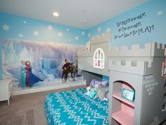 What girl doesn't like the icy blue hue of Elsa's dress? The comforter matches it perfectly in this room that princesses everywhere would love to call their own. The mural depicts the Snow Queen and Anna in the winter wonderland that surrounds her icy castle. In lieu of a backboard, this room comes alive with a 3D castle that surrounds the bed from wall to wall and features not only shelving but a secret bunk space as well.