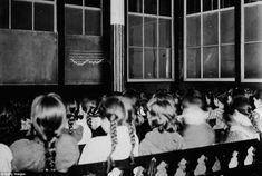 Girls in classroom: Rear view of rows of schoolgirls seated on benches in an East Side Public School circa 1890