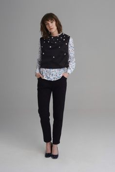 Black cropped sleeveless vest top with darted bust and back. The front is embellished with flower shaped iridescent sequin appliques. Sequin Appliques, Fuji, Polka Dot Top, Anna, Sequins, Vest, Black, Tops, Women