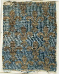 Textile with Brocade   Date: 13th–14th century  Culture: French or Italian  Medium: Silk, metal thread  Dimensions: Overall: 4 13/16 × 3 1/2 in. (12.3 × 8.9 cm) Storage (Mat with 46.156.54): 8 1/2 × 13 in. (21.6 × 33 cm)  Classification: Textiles-Woven-Brocade