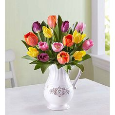 What better way to welcome spring than with our bright tulips? We've gathered bold blooms in a variety of shades in our exclusive Charlotte Pitcher, an antique-inspired, white, food-safe ceramic pitcher that can be repurposed as a serving vessel or decor piece! Send Mother's Day #Flowers Online