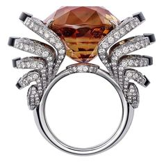 L'Odyssée de Cartier Parcours d'un Style high jewellery ring in white gold, set with a 33.42ct brown tourmaline, obsidian and diamonds. (The Vault) by Eva