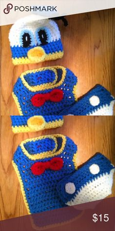 Brand new crocheted Donald Duck photo prop outfit Brand new hand made/ crocheted. Machine washable . Sizes already made are newborn and 6 months old but upon request can make you the size you need Costumes Seasonal