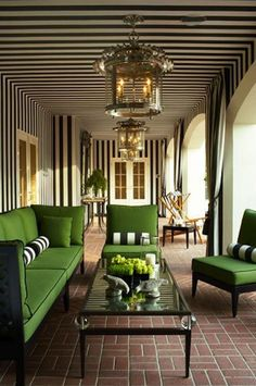 These black and white stripes give the illusion of an indoor living space while still being outdoors.