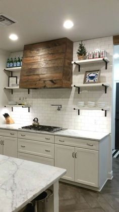 Rustic Barn Wood Hood Vent - Cooktop / Range Hood White Kitchen with wood hood. White subway tile wall.