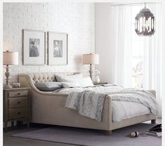 Generous tufting on the back and sides of the Restoration Hardware platform-style bed offers all the comfort of a sofa.