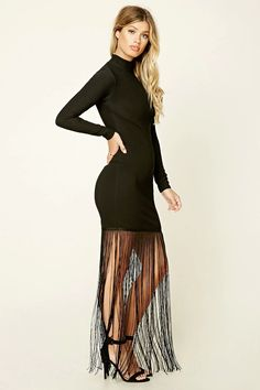 A stretch-knit dress by Rare London™ featuring a mock neckline, long sleeves, fringed hem, and a concealed back zipper.