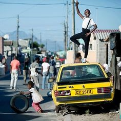Sikhumbuzo Hlahleni, a young ballet student, posing for pictures outside his family house. Move Over, Ballet School, Yoga Bag, Poses For Pictures, Young Black, Just Dance, Advertising Campaign, African Fashion, Cool Kids
