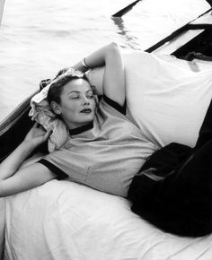 American actor Gene Tierney, wearing a striped short-sleeved shirt, lounges on a gondola boat, Venice, Italy. Old Hollywood, Viejo Hollywood, Classic Hollywood, Gene Tierney, Wearing A Tuxedo, Jean Simmons, Eddie Fisher, Fritz Lang, Vivien Leigh
