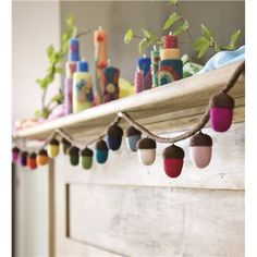 Acorn Garland is Magic Cabin® Exclusive – A rainbow of acorns hang from this wool felt garland. Plus, it's wonderfully versatile—hang it from a doorframe, above a window, or elsewhere inside the home—all year long! Autumn Crafts, Holiday Crafts, Acorn Crafts, Waldorf Crafts, Navidad Diy, Felt Garland, Kids Party Decorations, Acorn Decorations, Autumn Decorating