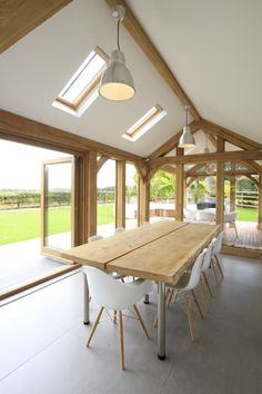 Beautiful oak buildings individually designed. Created by our artisan craftsmen, we marry old and new combining traditional skills and materials with contemporary living. Modern looks from age old timber, we capture the inherit beauty of oak creating inspirational interiors and aspirational design. Porch, outhouse, extension, design, architecture, contemporary, crafted oak, artisan, snug room, country living, garage, oak frame, interior, beams, bedroom, living room, kitchen, conservatory
