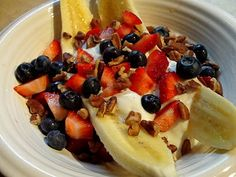 Breakfast Banana Splits -  Try 1 sm banana, peeled and halved lengthwise 1 Tbsp natural peanut butter 1 sm container 0% vanilla Greek yogurt 2 Tbsp high-fiber, low-sugar cereal Fruit (optional) such as strawberries, blueberries, or pineapple
