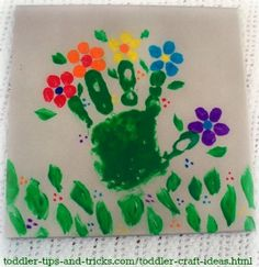Cute painted tile craft idea. Just use your toddler's hand-print then add flowers to make this little art project.
