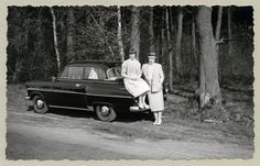 """https://flic.kr/p/PD143j   Opel Olympia Rekord   Two ladies – possibly mother and daughter – posing with an Opel in the countryside. The following words in German are handwritten on reverse: """"Auf der Landstraße bei Ahaus in Westfalen auf der Fahrt nach Rheine"""" (on the road near Ahaus in Westphalia on the way to Rheine). The print is dated 22. Apr. 1957.  Country of origin: Germany"""