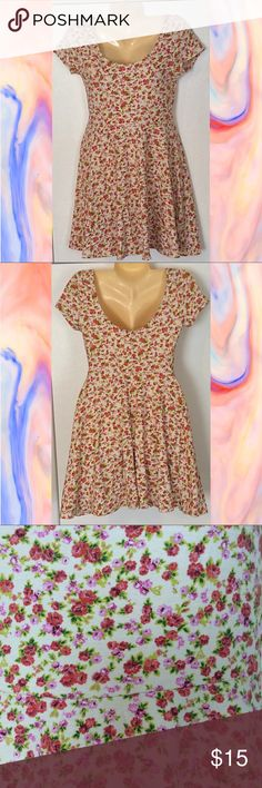 Floral Skater Dress Floral skater dress with a scoop neck and low cut back. Lightweight and perfect for summer! Size Large. Soprano Dresses Mini