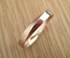 Exclusive to Benati. Mobius wedding ring crafted in 14k solid rose gold in approx. 4.5mm width (~0.17) - a beautiful meaningful symbol on your finger. A perfect wedding band! This ring is made to perfection and has a smooth and comfortable feel. Made to the highest standards. This is a very