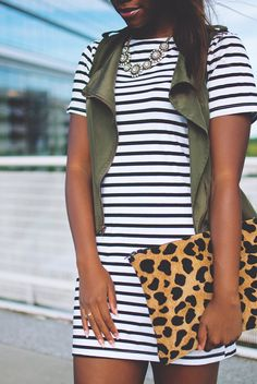 Outfit inspiration: striped t-shirt dress, leopard clutch and a cargo vest.
