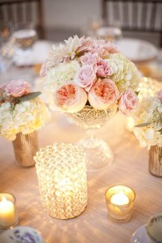 Romantic centerpiece with beautiful layers of flowers and candles.