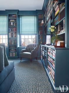 In the library of this Manhattan townhouse decorated by Vicente Wolf, the tufted armchair is covered in a metallic leather by Edelman | archdigest.com