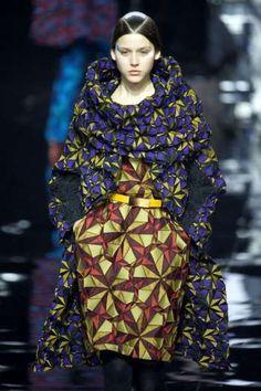 A model presents a creation by Japanese designer Yoshiyuki Miyamae as part of his Autumn/Winter 2015/2016 women's ready-to-wear collection fashion house Issey Miyake during Paris Fashion Week