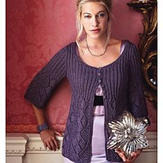 "Pattern Descriptions from Vogue Knitting, Holiday 2008: ""Worked in one piece to the underarms, the body of this cardigan - designed by Deborah newton and knit in 'Grand Opera' from Nashua Handknits/Westminster Fibers - transitions from a flowing diamond-lace pattern into a k2, p2 ribbing at the bodice. Other features include three-quarter sleeves, seed stitch at the front bands and skinny ribbing at the neckband."""