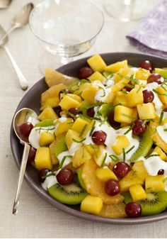 Fabulous Tropical Fruit Salad — Enjoy the flavors of the tropics any time of year with this colorful fruit salad recipe.  The sweetened sour cream topping adds the perfect finishing touch.