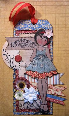 Tag created using Julie Nutting paper doll stamp from Prima..