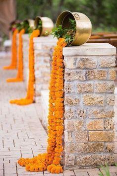 Marigold waterfall Indian wedding aisle decor with brass accents #weddingdecoration #weddingceremony #IndianWeddingIdeas