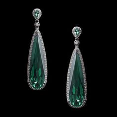 These elegant earrings feature a gorgeous emerald stone and pave set clear cubic zirconia set in sterling silver.